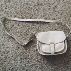 Cream Forever 21 cross-body small handbag Forever 21 Cream Colored cross-body handbag with adjustable strap and magnetic clasp closure. Inside has a zipped pouch as well as a pocket. Additional carrying space in the front of the bag. Never worn before. Forever 21 Bags Crossbody Bags