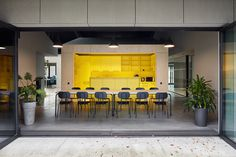 """Small and simple office building which fits seamlessly into the surrounding area, built within a limited construction budget. Laconic but sophisticated inner structure contains spatial intrigues, diverse use options and different atmospheres — semi-open office space accommodates few office rooms — """"boxes"""" along with spaces in-between them, usable for other supporting purposes — meeting rooms, a silence room, resting space, a play room, a kitchen and a dining room with a terrace. Fresh Juice Bar, Open Space Office, Riga, Office Interiors, Playroom, Terrace, Meeting Rooms, Construction, Building"""