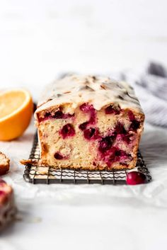 Citrusy sweet and tart Cranberry Orange Bread is quick and easy to make with fresh or frozen cranberries and an easy orange glaze. It's a delicious for breakfast, snacking, or gifting to friends or neighbors! #best #glazed #cranberry #orange #bread #quick #easy #quickbread #holiday #simple #homemade #fromscratch #fresh #oranges #cranberries