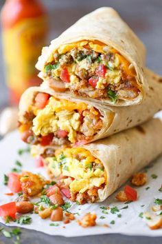 Freezer Breakfast Burritos - Meal prep over the weekend for the best burritos during the week. Loaded with tater tots, eggs, beans and cheese, of course! Frozen Breakfast Burritos, Breakfast Wraps, Best Breakfast Recipes, Vegetarian Breakfast, Breakfast Items, Breakfast Dishes, Brunch Recipes, Freezer Meals, Easy Meals