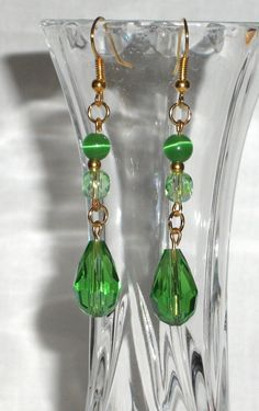 Earrings with pendant green crystals and light by Momentidoro, €17.00