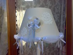 Handmade lampshade from offwhite silk handpainted with white flowers and decorated with handmade fabric ornaments. Especially made for babyroom by atelier iOPPi