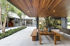 Central courtyard of the residence with an outdoor dining space