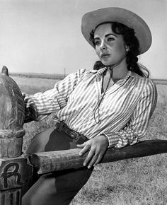 Elizabeth Taylor...aka Leslie Benedict in GIANT (1956). She looks like such a child in this pic but you're definitely seeing a women on film.