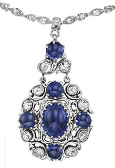 Tiffany & Co.     A Sapphire and Diamond Necklace, 1920.                 The front suspending an openwork pendant, centering upon a cabochon sapphire, weighing approximately 6.98 carats, within an old-cut diamond and cabochon sapphire frame, to the circular-cut diamond back chain, mounted in 18K white and yellow gold, length 22 inches. Signed 'Tiffany & Co.'   Philips de Pury.