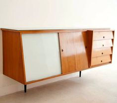 Georges Van Rijk; Cherry, Glass and Brass Wall-Mounted Sideboard, 1954.