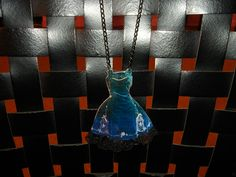 "Liquid resin pendant. ""Vintage dress"" with lace."