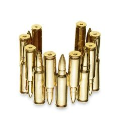 Jennifer Fisher Bullet Cuff - I've been into really tough statement jewelry lately. Sometimes it's nice to break up the monotony of a feminine or plain outfit with a really surprising piece of statement jewelry like a cuff or ring.