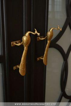Elevate those plain doors with some vintage-y door handles.