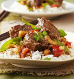 Recipe For Slow Cooker Asian Style Beef  - Chunks of beef get meltingly tender in the slow cooker, simmered in an Asian-inspired blend of toasted sesame dressing, garlic and teriyaki sauce with cashews. YUM!