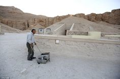 Mr Watanabe runs his scanning machine outside the burial chamber in the hope of finding mo...