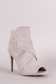 Free SH & Easy Returns! Shop  Suede Crisscross Slashed Stiletto Booties. These booties features a slashed crisscrossing straps detail, peep toe, and stiletto heel.