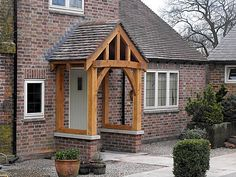 Adding a porch/portico is an opportunity to add interest to your home as well as to gain protection from the weather when entering or exiting your front door. Source by BreiaLee Porch Uk, Cottage Porch, Porch Roof, House With Porch, House Front, Cottage Style, Brick Porch, Pergola Roof, Brick Wall