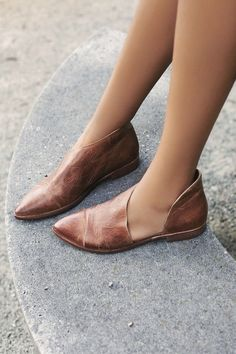 High quality genuine leather Leather flats with side cutouts and a slight stacked heel. Made with the finest Spanish craftsmanship. Suggested sizing: Runs SMALL. I am a size 9 (sometimes 9.5) and wear