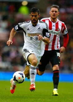 Jordi Amat of Swansea City is chased by Connor Wickham of Sunderland during the Barclays Premier League match between Sunderland and Swansea...