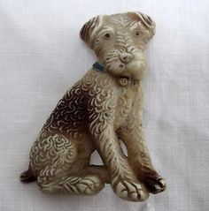 A VERY SWEET ART DECO AIREDALE TERRIER CELLULOID BROOCH