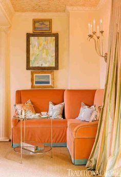 Cozy corner banquette upholstered in salmon-colored velvet!  Designer Shazalynn Cavin-Winfrey