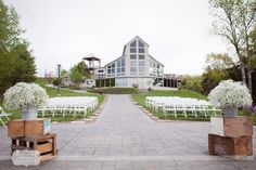 Gorgeous outdoor winery wedding venue in central Missouri - the Les Bourgeois Winery has a patio ceremony site overlooking the Missouri River. Here is a great example of what this venue looks like with a ceremony set up outside.
