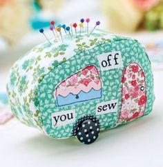 Cut letters from text fabric to spell 'off you sew', then glue and stitch into place using cream thread.