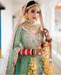 love this brides multi coloured bridal lehenga. wedding jewellery Where Can One Shop Wedding Jewellery Online - Indian Bridal Photos, Indian Bridal Outfits, Indian Bridal Fashion, Asian Bridal, Blue Bridal, Indian Dresses, Bridal Looks, Bridal Style, Muslim Wedding Dresses