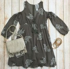 The Sweetest Thing Dress is a lovely taupe babydoll dress with attached sleeves. This high quality piece has cut out shoulders, tassel detail along the front, and full zipper along the back. Our favorite part is the gorgeous ivory embroidery! Wear this piece to a country concert with your favorite boots or date night with some wedges. Either way you will look darling! #concert #ootd #boho #fashion (privityboutique.com)