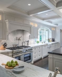 From the rich hardwood floors to the spectacular coffered ceiling and every element in between - this truly is the perfect kitchen! By Architectural Kitchens