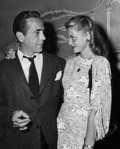 Lauren Bacall & Humphrey Bogart...I love how she's looking at him:)
