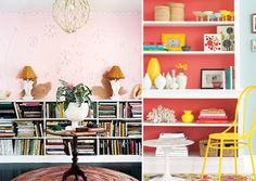 i really love the idea of painting the back of a bookshelf (or the wall behind it if it's backless). i want to do this to a hutch we have, but willy won't let me. :/