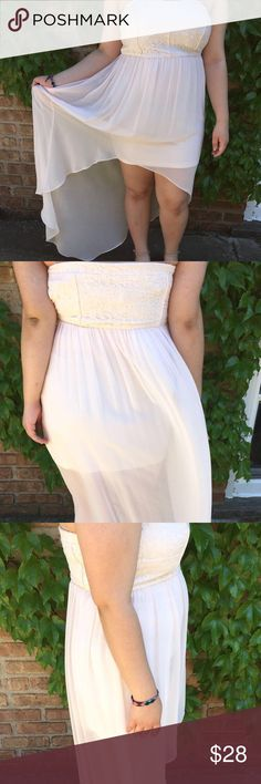 White Dress Only been worn once. White lace Sequined top half. Bottom half is white and flows. It's a high-low dress. Dresses High Low