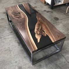 "Dry fitting the steel base for the resin river table. 1/2"" float above frame. #design #industrial #mnmade #metal #metalfab #woodandsteel #woodandmetal #woodwork #wood #woodworking #handcrafted #customdesign #metalfab #metalwork #customfurniture #minnesota #minneapolis #water #nofilter #modern #rustic #reclaimed #resin #mississippiriver #river #walnut #coffeetable #festool #festoolme #rivertable #nofilter"
