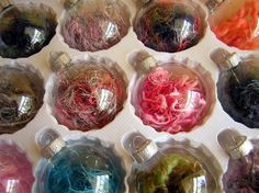 Clear ornaments filled with pieces of yarn...