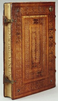 Pietro Bembo (1470-1547) Historiae Venetae libri XII 1551 31 cm (Height) x 5 cm (Depth) ... This mid-sixteenth-century binding is in a sober Renaissance style which was more common around 1500, with three concentric rectangles of repeated small stamps. The author and title have been tooled in gold on the back board and written on the fore-edge, indicating that the book was intended to be stored flat with the fore-edge outermost.