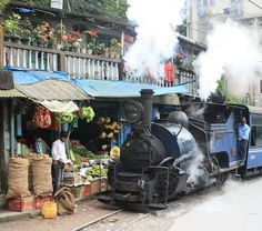 """The Darjeeling Himalayan Railway is the first, and still the most outstanding example of a hill passenger Railway. It is also known as the """"Toy Train"""" of Indian Railways. Train Route, Amazing India, It's Amazing, Hill Station, Train Station, Train Journey, India Travel, Historical Sites, Heritage Site"""