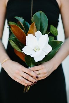 Magnolia leaf bouquet- love the large single flower and the greenery. If Magnolia leaf is unavailable, other large leaf greens may be substituted. Big Bouquet Of Flowers, Flower Bouquet Wedding, Floral Wedding, Single Flower Bouquet, Palm Wedding, Wedding Table, Gardenia Bouquet, Bridal Bouquets, Purple Wedding