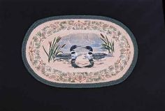 """HAND PRINTED LOON RUG - This rug has been hand printed with as many as ten different colours! Detailed images with unparalleled shading and colour sets the standard for this beautiful rug. 20"""" x 30""""."""