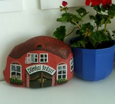 Love these little Stonehomes.  A great idea for a doorstop.  Fun for a child's garden.  Make believe play - create a town!