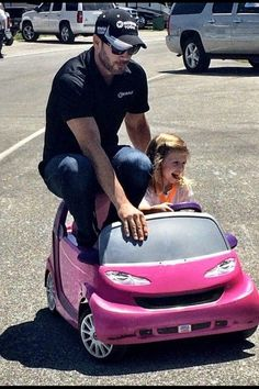 Jimmie with Evie  Looks like Evie will follow in Jimmie's career as a race car driver-look at that facial expression!