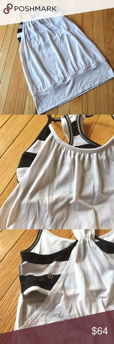 """Lululemon no limits white black striped tank Sz 6 White tank with black and white striped attached sports bra. Banded at waist, open and loose material for great ventilation during workouts to keep cool. Great condition except rip tag and bust inserts missing. No longer made!  Length approx. 26"""" long. l lululemon athletica Tops Tank Tops"""