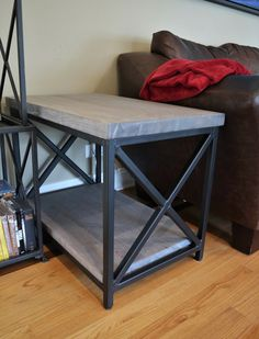 This handmade side table was built with a solid metal frame for the quarter sawn white oak top and bottom shelves. The white oak is showing off a gray stain with a white ceruse on the top.  #SideTables #CustomFurniture #HomeDecor #LivingRoom #Metalwork #WoodAndMetal #SmallTables #Ceruse #WhiteOak #QuarterSawn #MetalX #ChicagoWoodworking #AmericanMade