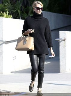 LOVE! The leather skinnies and the look of Charlize Theron!