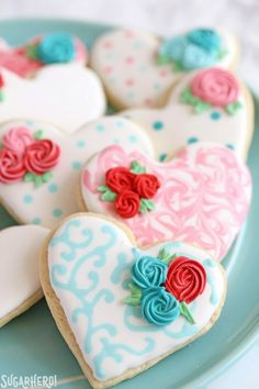 Valentine's Day Sugar Cookies - sugar cookies with swirled design and piped rosettes on top | From SugarHero.com