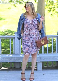 Touch of denim via this denim jacket over this printed Summer dress from @cabiclothing, @target sandal heels and a @ToryBurch purse. Perfect Spring/Summer 2016 look! Also a great casual look for a bbq or lunch!