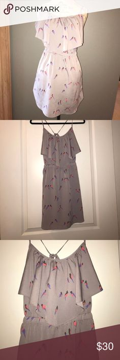 Light Purple Dress with Bird Pattern Light purple dress with spaghetti straps that tie in the back. Sinched elastic waist and flowy bodice detail. Measures approx: 15 inch bust. 12.5 inch waist, 31 inches long American Eagle Outfitters Dresses Mini