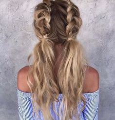 Two tied messy French-braided pigtails— love the wavy, texturized ends.