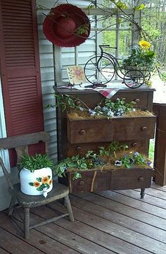 dresser drawers as flower beds. or pull drawers out and stack on an old ladder.