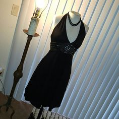 100%silk Adrianna Papell little black mini dress Halter tie back silk dress. Fully lined flare bottom. Size 10 made in India. Has mixed sequins and beading around the waist. Good condition. Worn 3 tines.runs small can fit size 8 too. Bust 30', waist 28, length31 Adrianna Papell Dresses Backless