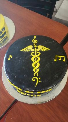 Black and yellow marble cake with cannoli filling , black fondant and yellow wafer paper music notes and nurses design
