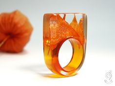 Physalis flames – hot blossom ring with a real, tender, orange coloured physalis petals on an orange ringe made of resin by GeschmeideUnterTeck on Etsy https://www.etsy.com/listing/155815156/physalis-flames-hot-blossom-ring-with-a
