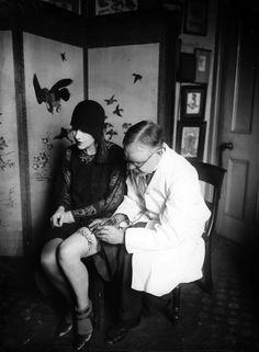 Tattoo artist George Burchett working on a client's thigh