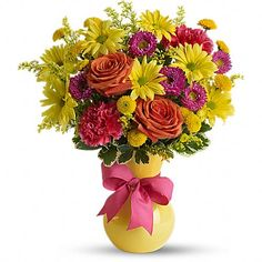 Hooray-diant! - [T09J300A]  Its called Hoo-radiant! The perfect name for this exuberant gift of orange roses, hot pink carnations and other favorites bursting from a sunny yellow vase theyll love. Go ahead, make their day.
